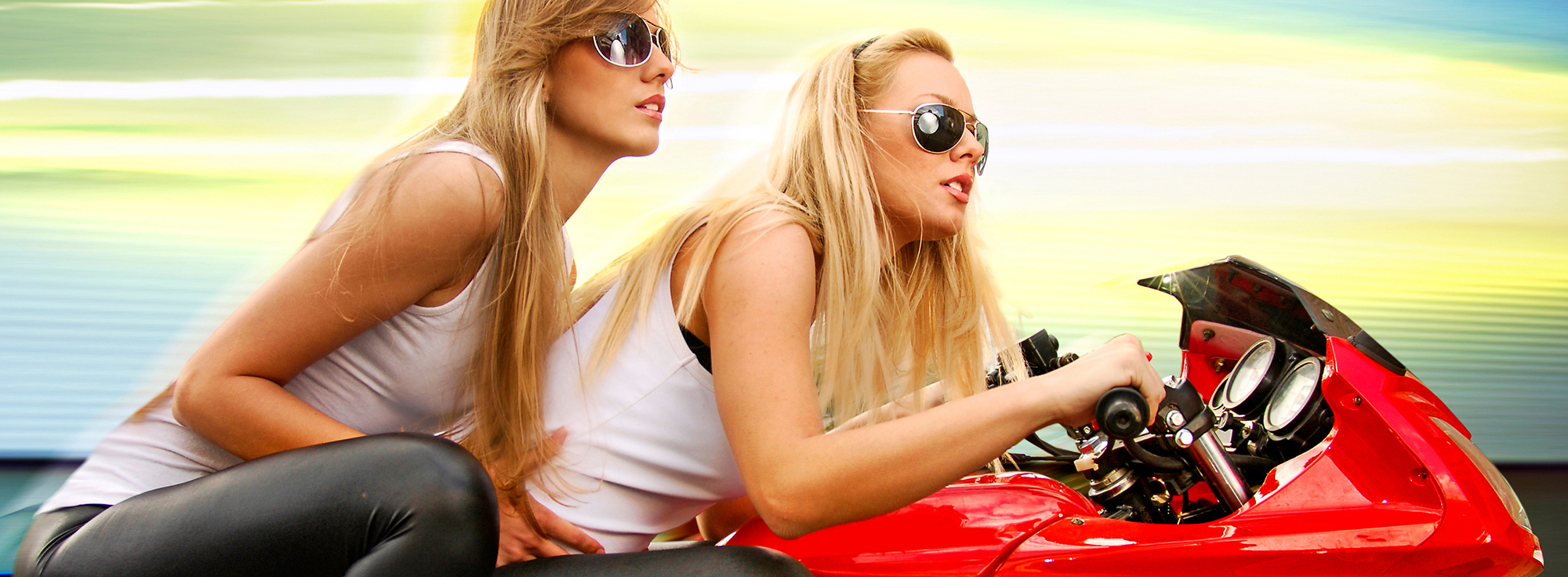 two blonde on a motorcycle